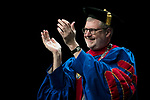 The Rev. Dennis H. Holtschneider, C.M., president of DePaul, applauds graduates Saturday, June 10, 2017, during the DePaul University College of Education commencement ceremony at the Rosemont Theatre in Rosemont, IL. (DePaul University/Jeff Carrion)