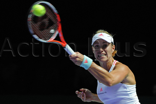 25.10.2016. Singapore, Malaysia. WTA Finals Singapore Open.  Angelique Kerber of Germany competes during the WTA Tennis  Womens Finals round robin match against Simona Halep of Romania at Singapore Indoor Stadium, Oct. 25, 2016. Kerber won 2-0.