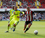 Richard Keogh of Derby County challenges Billy Sharp of Sheffield Utd during the Championship match at Bramall Lane, Sheffield. Picture date 26th August 2017. Picture credit should read: Simon Bellis/Sportimage