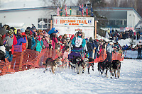 Angie Taggart runs down the chute on Willow Lake after leaving the re-start line of the Iditarod sled dog race in Willow, Alaska Sunday, March 3, 2013.