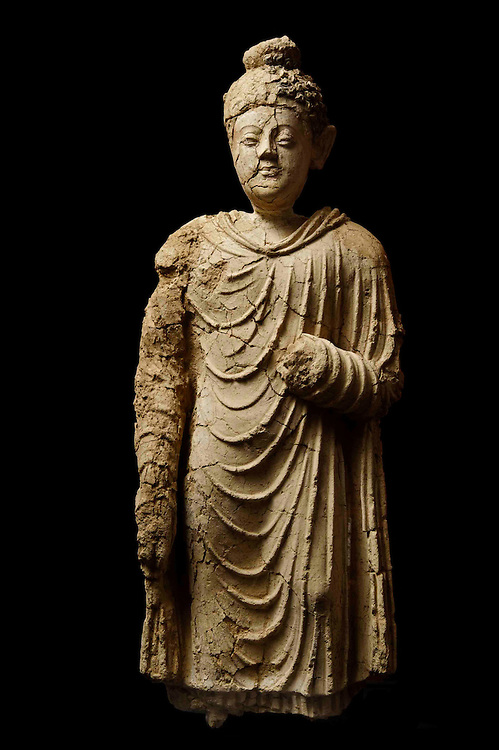 MES AYNAC, AFGHANISTAN - MAY 12 - standing buddha, clay painted, height 66cm , 4th-7th century CE, from Mes Aynak .