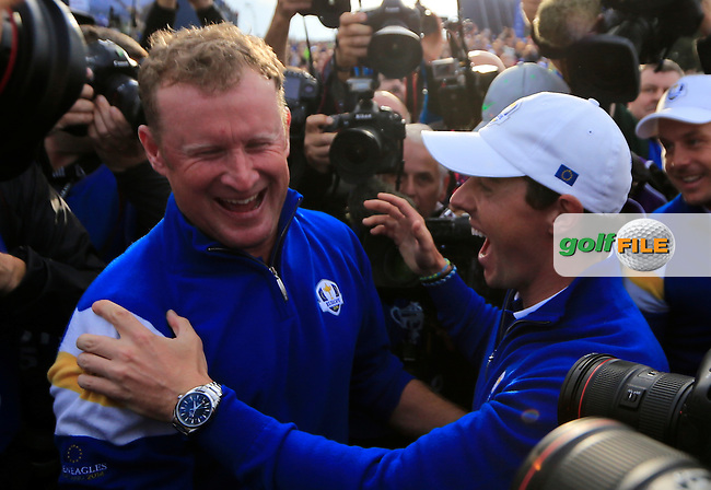 Jamie Donaldson celebrates with Rory McIlroy (EUR) after securing the winning points on the 15th green during the Sunday Singles Matches at the 2014 Ryder Cup at Gleneagles. The 40th Ryder Cup is being played over the PGA Centenary Course at The Gleneagles Hotel, Perthshire from 26th to 28th September 2014.: Picture Fran Caffrey, www.golffile.ie: \28/09/2014\