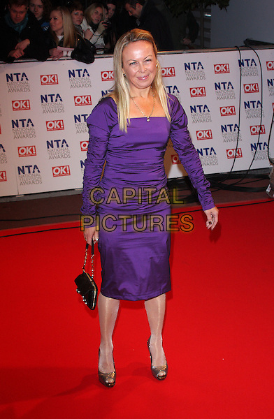 JAYNE TORVILL.The 15th National Television Awards held at the O2 Arena, London, England. .January 20th, 2010 .NTA NTAs full length purple dress long sleeved sleeves ruched silver shiny metallic peep toe shoes jane.CAP/ROS.©Steve Ross/Capital Pictures.