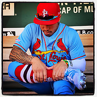 OAKLAND, CA - AUGUST 3: iPhone Instagram of Kolten Wong of the St. Louis Cardinals sitting in the dugout before the game against the Oakland Athletics at the Oakland Coliseum on August 3, 2019 in Oakland, California. (Photo by Brad Mangin)