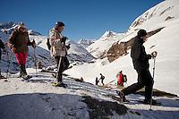 A group of visitors on snowshoes explore LEcot, a hamlet close to Bonneval sur Arc, Savoie, France, 17 February 2012.