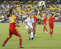 Carli Lloyd #10 of the USA WNT sends the ball past Gaoping Zhou #20 of the PRC WNT during an international friendly match at KSU Soccer Stadium, on October 2 2010 in Kennesaw, Georgia. USA won 2-1.