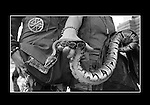 A couple shows off thier pet snake on Haight in San Francisco, California.