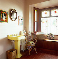 The tiled bathroom benefits from a bay window which opens onto the verandah which surrounds the house