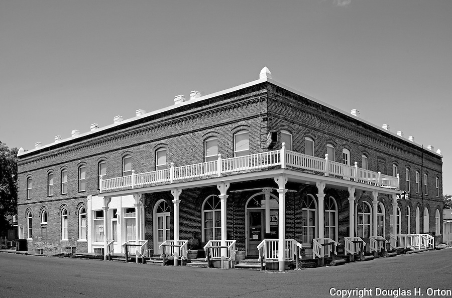 The renovated Shaniko hotel stands above the dusty Oregon ghost town of Shaniko.  Once undergoing restoration, the town of friendly people is again falling into disrepair.  Journey Through Time Scenic Byway.