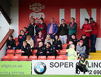 Fleetwood Town fans watch their team in action<br /> <br /> Photographer Andrew Vaughan/CameraSport<br /> <br /> The EFL Sky Bet League One - Lincoln City v Fleetwood Town - Saturday 31st August 2019 - Sincil Bank - Lincoln<br /> <br /> World Copyright © 2019 CameraSport. All rights reserved. 43 Linden Ave. Countesthorpe. Leicester. England. LE8 5PG - Tel: +44 (0) 116 277 4147 - admin@camerasport.com - www.camerasport.com