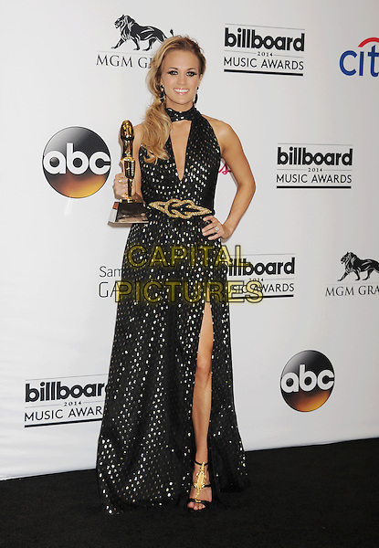 LAS VEGAS, CA- MAY 18: Singer Carrie Underwood, winner of the Milestone Award, poses in the press room at the 2014 Billboard Music Awards at the MGM Grand Garden Arena on May 18, 2014 in Las Vegas, Nevada.<br /> CAP/ROT/TM<br /> &copy;Tony Michaels/Roth Stock/Capital Pictures