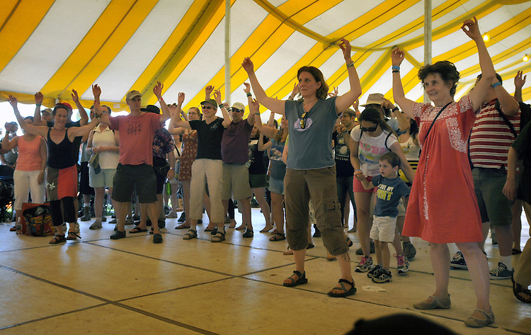 Members of the audience dancing to the Galician Bagpipe Fusion music played by Cristina Pato, on the Dance Stage, on the first day of the Clearwater's Great Hudson River Revival Festival 2013, held at Croton Point Park, in Croton-on-Hudson, NY, June 15, 2013. Photo by Jim Peppler. Copyright Jim Peppler 2013 all rights reserved.