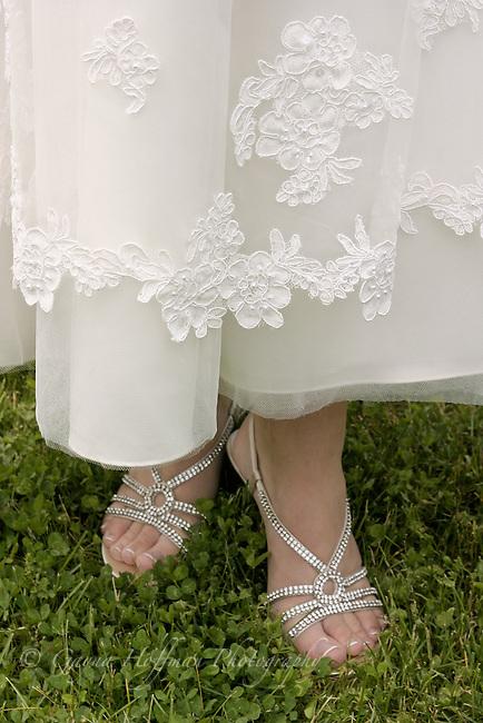 Bride's feet in sandals.