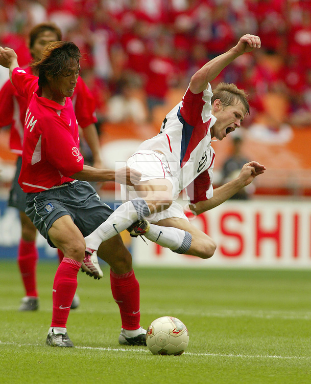 Brian McBride is fouled. The USA tied South Korea, 1-1, during the FIFA World Cup 2002 in Daegu, Korea.