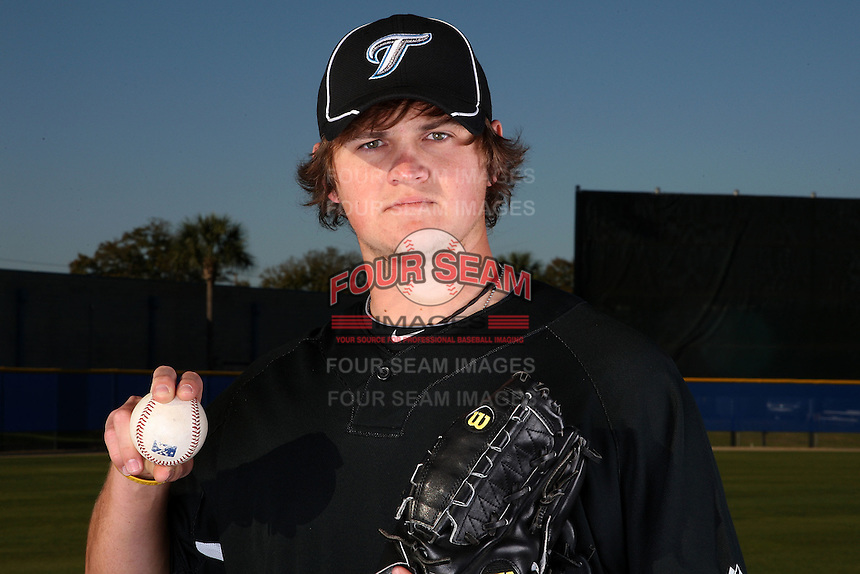 March 1, 2010:  2009 first round draft pick Chad Jenkins (pitcher #64) of the Toronto Blue Jays poses for a photo during media day at Englebert Complex in Dunedin, FL.  Photo By Mike Janes/Four Seam Images