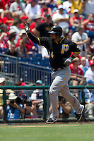 Pittsburgh Pirates  first baseman Casey McGhee #14 trots around the bases after his first inning home run in the Major League Baseball game against the Philadelphia Phillies on June 28, 2012 at Citizens Bank Park in Philadelphia, Pennsylvania. The Pirates defeated the Phillies 5-4. (Andrew Woolley/Four Seam Images).