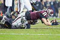 Texas A&M quarterback Kyle Allen (10) is sacked by Missouri defensive lineman Shane Ray (56) and linebacker Michael Scherer (30) during an NCAA football game, Saturday, November 15, 2014 in College Station, Tex. Missouri defeated Texas A&M 34-27. (Mo Khursheed/TFV Media via AP Images)