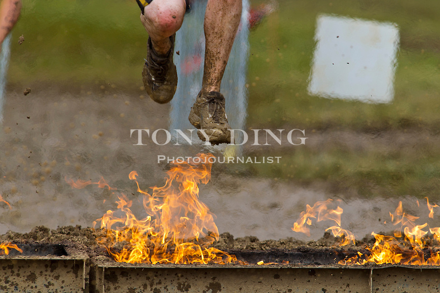 16 April 2010: A competitor makes way through the Firewalker, one of twenty obstacles in the Tough Mudder adventure endurance race at Michigan International Speedway in Brooklyn, Michigan.