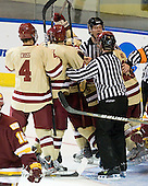 Tommy Cross (BC - 4), Edwin Shea (BC - 8), Bill Arnold (BC - 24) and Steven Whitney (BC - 21) celebrate Arnold's goal. - The Boston College Eagles defeated the University of Minnesota Duluth Bulldogs 4-0 to win the NCAA Northeast Regional on Sunday, March 25, 2012, at the DCU Center in Worcester, Massachusetts.