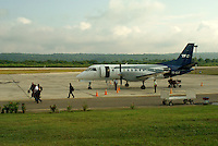 Passengers getting off a prop plane at the Santa Elena Airport or Mundo Maya Airport, El Peten, Guatemala