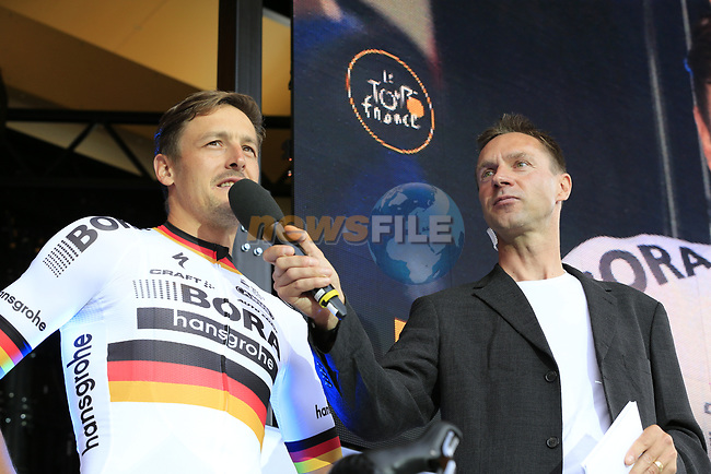 German National Champion Emanuel Buchmann (GER) Bora-Hansgrohe team talks to MC Jens Voigt on stage at the Team Presentation in Burgplatz Dusseldorf before the 104th edition of the Tour de France 2017, Dusseldorf, Germany. 29th June 2017.<br /> Picture: Eoin Clarke | Cyclefile<br /> <br /> <br /> All photos usage must carry mandatory copyright credit (&copy; Cyclefile | Eoin Clarke)