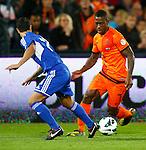 Nederland, Rotterdam, 12 oktober 2012.Kwalificatiewedstrijd WK 2014.Nederland-Andorra .Ruben Schaken (r.) van Oranje probeert Victor Moreira Teixeira (l.) van Andorra te passeren.