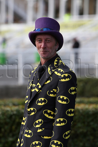 09.04.2016. Aintree, Liverpool, England. Crabbies Grand National Festival Day 3. Batman suited racegoer in front of the grandstands.