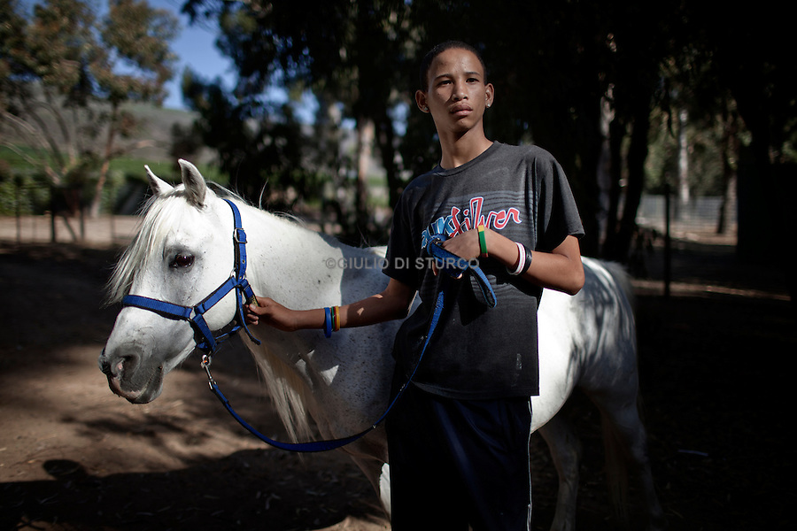 CAPE TOWN, SOUTH AFRICA JANUARY 2011:<br />Nashwin Andreas, 15,here at the second week of a 6 week equine therapy programme. Jan 2011 @ GDS