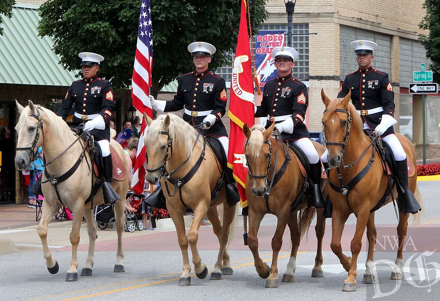 NWA Democrat-Gazette/DAVID GOTTSCHALK  The United States Marine Corp Mounted Color Guard make their way along Emma Avenue June 21, 2017, as they participate in the annual Rodeo of the Ozarks Parade in Springdale. The parade kicks off the 73rd annual rodeo that opened Wednesday evening and runs through Saturday at Parsons Stadium.