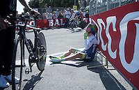 Simon Clarke (AUS/Orica-GreenEDGE) needed to sit down immediately after finishing (and winning) the opening TTT of the 2015 Giro d'Italia<br /> <br /> finish zone of stage 1: San Lorenzo Al Mare - San remo (TTT/17.6km)