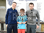 Ardee Celtic's U-12 player of the year Michael Reid with coaches Sean Keenan and Anthony Geraghty. Photo:Colin Bell/pressphotos.ie