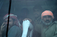 Former iraqi prisoners wait while on the bus to be taken home autside of the prison of Abu Graib in BAghdad on MAy 28 2004. in the same day 400 prisoners will be relased.