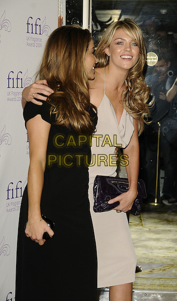 ELEN RIVAS & ABIGAIL CLANCY.Fifi UK Fragrance Awards 2009, The Dorchester hotel, London, England..April 22nd 2009.half 3/4 length beige cream dress purple Balenciaga clutch bag halterneck tanned Abi abby abbey clancey black profile arm over shoulder .CAP/CAN.©Can Nguyen/Capital Pictures.