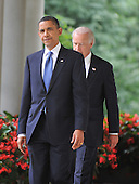 Washington, D.C. - June 22, 2009 -- United States President Barack Obama, left, and Vice President Joseph Biden, right, walk on the colonnade to the Rose Garden for the signing of the Family Smoking Prevention and Tobacco Control Act in the Rose Garden of the White House on Monday, June 22, 2009..Credit: Ron Sachs - Pool via CNP
