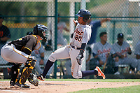 Detroit Tigers shortstop Wenceel Perez (80) slides home in front of catcher Jason Delay (64) during a Florida Instructional League game against the Pittsburgh Pirates on October 2, 2018 at the Pirate City in Bradenton, Florida.  (Mike Janes/Four Seam Images)