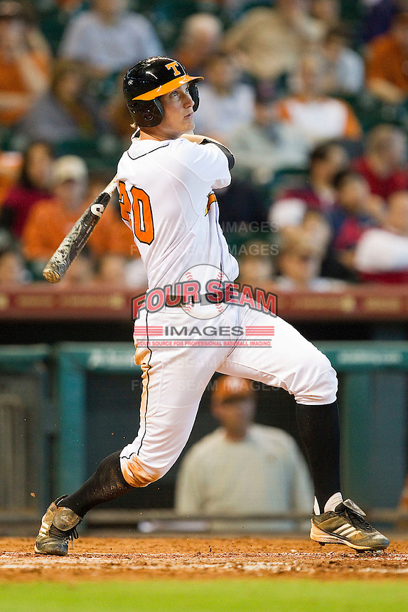 Drew Steckenrider #20 of the Tennessee Volunteers follows through on his swing against the Texas Longhorns at Minute Maid Park on March 3, 2012 in Houston, Texas.  The Volunteers defeated the Longhorns 5-4.  Brian Westerholt / Four Seam Images
