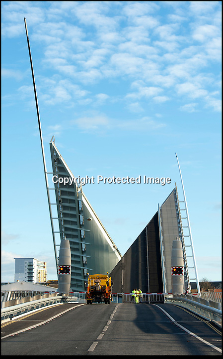 BNPS.co.uk(01202 558833)<br /> Pic: CorinMesser/BNPS.<br /> <br /> A pensioner had a miracle escape when she crashed her car through a safety barrier and jumped across a gap in a lifting bridge.<br /> <br /> In a scene more reminiscent to an action movie, the 86-year-old woman drove at 20mph through flashing red lights warning motorists the Poole harbour bridge was opening.<br /> <br /> Her silver Renault Clio smashed into the red and white gate and carried on along the road bridge as it was being raised.<br /> <br /> The sudden incline in the surface acted as a ramp and the pensioner's small vehicle shot off the end of the carriageway and plunged 6ft before landing on the other side.<br /> <br /> The car then overturned, trapping the shocked but injured woman inside.