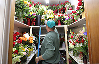 Rusty Eldridge, owner of the Springdale Flower Shop, stores an dozen confetti roses arrangement Wednesday, February 12, 2020, for a Valentines delivery from the florist shop in Springdale. Eldridge said that roses and lilies remain the favorite for Valentine's Day. Check out nwaonline.com/200213Daily/ and nwadg.com/photos for a photo gallery.<br /> (NWA Democrat-Gazette/David Gottschalk)