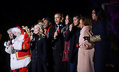 United States President Barack Obama and daughters Malia and Sasha, mother-in-law Marian Robinson,first lady Michelle Obama and actress Reese Witherspoon sing from the stage during the national Christmas tree lighting ceremony on the Ellipse south of the White House December 3, 2015 in Washington, DC. The lighting of the tree is an annual tradition attended by the President and the first family.<br /> Credit: Olivier Douliery / Pool via CNP
