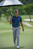 Lloyd Jefferson GO (PHI) departs the green on 11 during Rd 4 of the Asia-Pacific Amateur Championship, Sentosa Golf Club, Singapore. 10/7/2018.<br /> Picture: Golffile | Ken Murray<br /> <br /> <br /> All photo usage must carry mandatory copyright credit (&copy; Golffile | Ken Murray)