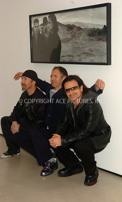 WWW.ACEPIXS.COM . . . . .  ....NEW YORK, OCTOBER 9, 2005....Anton Corbijn, The Edge and Bono attend the opening of Anton Corbijn's photo exhibition which shows a 22 year relationship with U2 at Stellan Holm Gallery.....Please byline: AJ Sokalner - ACE PICTURES..... *** ***..Ace Pictures, Inc:  ..Craig Ashby (212) 243-8787..e-mail: picturedesk@acepixs.com..web: http://www.acepixs.com