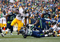 DeAngelo Williams #34 of the Pittsburgh Steelers runs with the ball through a tackle by Earl Thomas #29 of the Seattle Seahawks during the game at CenturyLink Field on November 29, 2015 in Seattle, Washington. (Photo by Jared Wickerham/DKPittsburghSports)