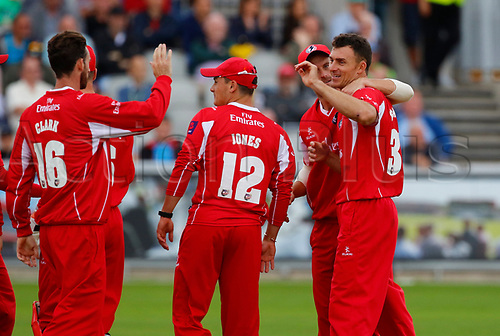 July 23rd 2017; Emirates Old Trafford, Manchester, England; Natwest T20 Blast; Lancashire versus Durham; Ryan McLaren (right) is congratulated by his Lancashire team mates after he takes the wicket of Graham Clark of Durham after Lancashire made 174-5 in their twenty overs