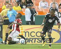 Rodney Wallace #22 of D.C. United trips Michael Lahoud #11 of Chivas USA during an MLS match at RFK Stadium, on May 29 2010 in Washington DC. United won 3-2.