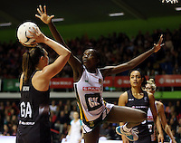 28.07.2015 Silver Ferns Malia Paseka and South Africa's Phumza Maweni in action during the Silver Fern v South Africa netball test match played at Trusts Arena in Auckland. Mandatory Photo Credit ©Michael Bradley.