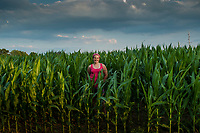 Karlee Scott poses in a field of corn near her family farm in afternoon sun.