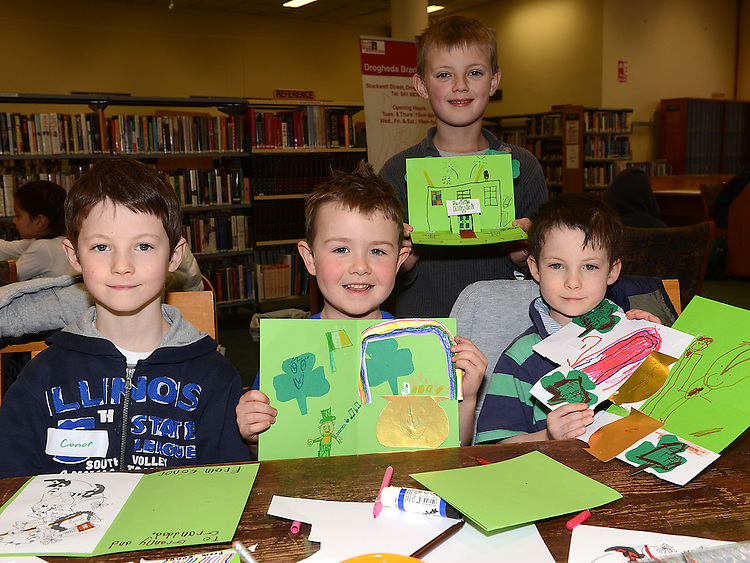 Eoin Johnston, Conor and Ethan Bowe and Edward McEntee pictured at the St Patrick's day art and craft session in the library. Photo:Colin Bell/pressphotos.ie