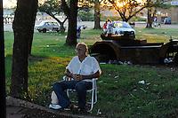 URUGUAY Salto, man with Mate tea at Rio uruguay in the evening
