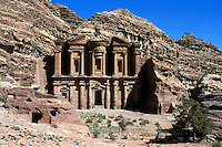 """Jordan. Petra. The archeological site is part of the UNESCO world heritage project.  The Nabataeans were an arabian industrious tribe which settled down in southern Jordan 2000 years ago. Petra is located at the bottom of a spectacular deep gorge surrounded by mountains. """" Al-Dayr"""" monastery. Its high façade is carved in the rocks.  A small open-air shop sells souvenirs, drinks, films and various objects to tourists. © 2002 Didier Ruef"""