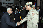 Egypt's interim President Adly Mansour (L) shake hands with Egypt's army chief Field Marshal Abdel Fattah al-Sisi (R), after his meeting with members of the Supreme Council of the Armed Forces, in Cairo March 26, 2014.Egypt's military leadership was presenting Field Marshal Abdel Fattah al-Sisi's resignation from his post of defence minister at a meeting with the interim head of state on Wednesday, the state-run Al-Ahram newspaper reported on its website. Sisi is required to step down from his positions in the military in order to mount a widely expected bid for the presidency, which he is forecast to win easily in a forthcoming election. apaimages/Military Moral Affairs